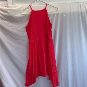 A Red/Coral Dress with black tie up string